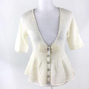 Anthropologie Knitted Knotted cream bow cardigan